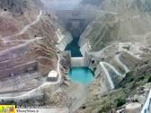 تاثیر دبی و عمق آب پاییندست حوضچه آرامش سرریز سد نمرود بر فشار دینامیكی كف حوضچه با استفاده از مدل فیزیكی