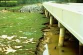 بررسی تغییرات زمانی پروفیل آبشستگی بستر چسبنده پایاب سرریزهای قائم